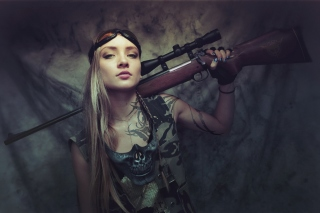 Обои Soldier girl with a sniper rifle на LG Spectrum