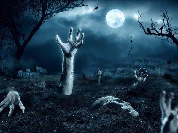 Zombie hand coming out of his grave — стоковое фото