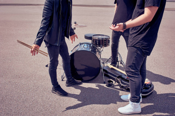 Partial View Rock Band Black Clothing Standing Musical Instruments Street — стоковое фото