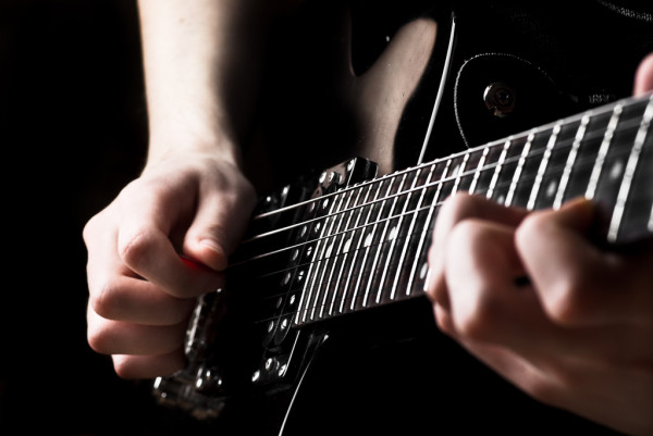 Electric guitar being played — стоковое фото