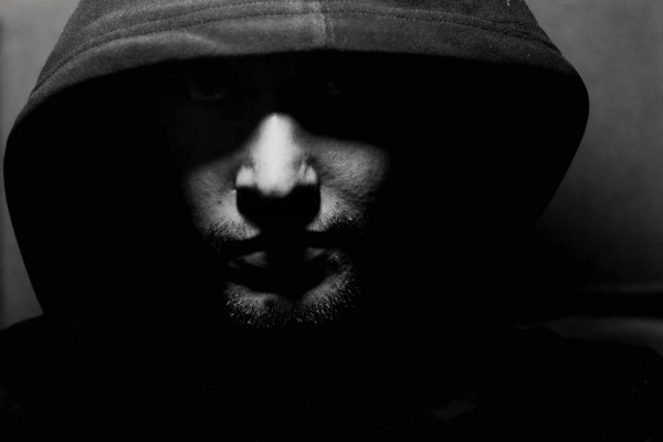 Monochrome picture of a guy in a hood — стоковое фото